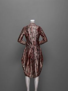 Alexander McQueen, Coat, Jack the Ripper Stalks His Victims (MA Graduation Collection), 1992    Pink silk satin printed in thorn pattern lined in white silk with encapsulated human hair    only slightly creepy
