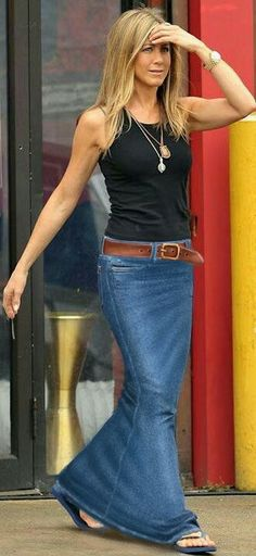 Jennifer Aniston looking hip,wearing a black vest top And long floor length denim maxi skirt