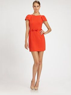 Love the tangerine orange and puffed sleeves on this Milly dress.  #fashion