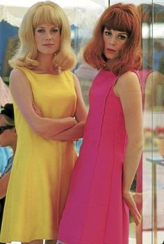 60s yellow pink shift dress hair style bangs bob color photo vintage style icons movie stars Catherine Deneuve and Francoise Dorleac in Les Demoiselles de Rochefort, 1967