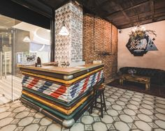Black Beard Barbershop by B&V Studio, Moscow. Love the use of steel pipe with paint finishes.