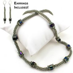 """This necklace was designed as a reminder to stop along the path of life and savor the important moments and events. The rope is made using cubic right angle weave, and the tila """"stepping stones are st"""