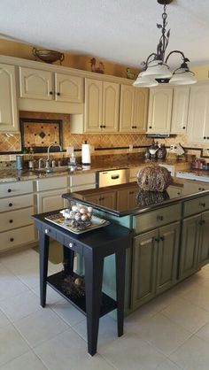 Kitchen cabinets and island painted with General Finishes milk paint.