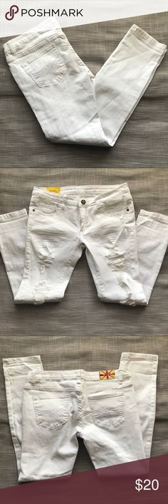 "Machine Nouvelle Mode Destroyed Wash 6 pocket - Zip fly White wash  Destroyed Wash  Low rise on hips  Measurements: Rise: 8"" Waist: 16"" Inseam: 27"" Leg: 6""  97% Rayon 3% Elastane  Measurements are approximate and taken laying flat as shown in pictures Machine Nouvelle Mode Jeans Skinny"