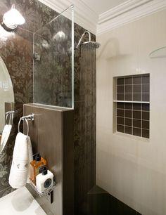 Walk-in shower with half wall and built in shelf.  Award Winning Bathroom Renovation