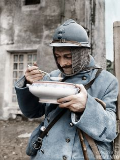 A French soldier eating soup, ca 1915 He's a 1st class soldier with what appears to be a sapper's specialist trade badge despite the fact that he wears a regular Adrian Helmet. Photo taken by Jacques Moreau, a professional photographer, mobilized at the age of 27, he produced 2,000 photographic plates in 4 years, on the daily life of the soldiers during the 14-18 War. (Colour and text by Toussaint Bonavita from France)