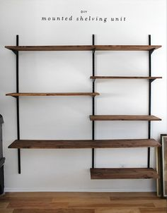 """wood that was about 3/4"""" thick cut into three sizes.  How to make a shelf. Diy Mounted Shelving Unit - Step 22 we then hung the uprights after measuring and remeasuring and leveling and stud finding and then i sanded and stained 12 pieces of wood. we live in an apartment with a small balcony. so yeah. that took a day. wood was ready to go and we then decided where each shelf would go, and screwed the brackets to the shelves. and that's about it!"""