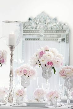 """Luxe centerpieces of varying height and beautiful styling, but I'd never use the glittery vases. I feel they make it all look like """"circus"""" and cheap. This display needs cut-crystal vases of the same shape, maybe gold-rimmed. The flowers should rather be ivory and peach to fit into the warm color scheme of the Old Mint."""