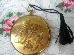 Vintage Pocket Watch Zell of Fifth Avenue Compact Moon and Flowers  One of my true loves is vintage compacts more of a jewelry accessory than simply makeup. I can email you instructions to add your own powder. Antique compacts are a show stopper when you powder your nose. $55.00.   10% of all of my sales of to Furry Friends   my favorite no kill shelter located in West Des Moines Iowa. Receipts posted on my Facebook