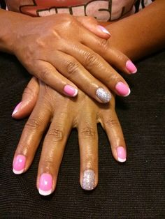 Hot pink French nails with silver glitter accent