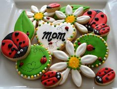 Ladybugs and daisies cookies/Mother's day cookie platter visit us at www.facebook.com/spbakes