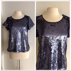 """Leifsdottir sequin top Leifsdottir sequin top. Brand new with tags. Size M. Measures 23"""" long with a 36"""" bust. This has no stretch to it. Somewhat heavy- this top has some weight to it. The inside is fully lined. Navy color. I do not see any missing  No trades. Poshmark onlyI am very open to fair offers! Anthropologie Tops"""