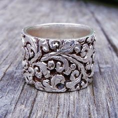 Hand Engraved Tibetan Silver Ring, with the lotus flower which is symbolic of purity of body, speech, and mind. I