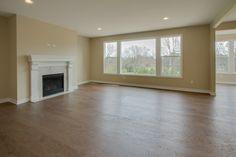 Large living space. Large windows. Custom painted mantle, gas fireplace. Wire brushed hardwood floors.