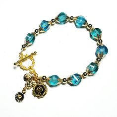 Only $8.25! - SALE Blue-Green & Teal Uniquely Shaped Faceted Beads Bracelet w/Dangling Clustered Gold Rose Charm, Golden Crystal Charms,  & Rhinestone Flower Charms FREE USA SHIPPING https://www.etsy.com/listing/398807315/sale-blue-green-teal-uniquely-shaped