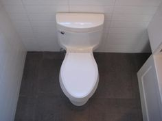 Toilet surrounds - the whole bathroom is tiled from floors, walls to ceilings