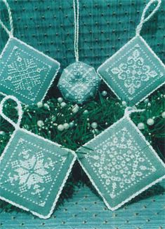 ScissorTail Designs Snowflake Ornaments - Cross Stitch Pattern. Stitch Count: 31W x 31H each. Models stitched on 28 Ct. Stoney Point linen using Weeks Dye Works