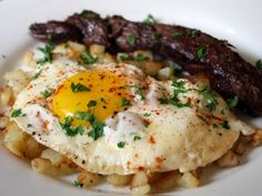 steak and eggs. steak and eggs. all i want it steak and eggs. yes, it's true. i quit the veggie thing a while ago. no offense. it's also hard to do with a parisian chef for a boyfriend.