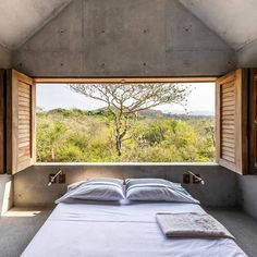 Casa Tiny Puerto Escondido Mexico Aranza Arino & Claudio Sodi (Air BnB) @arandearino  #casatiny #bedroom #roomwithaview #architecture #archidaily #archilovers #concrete #instarchitecture #instadesign #instainteriors #shutters #bed #interior #interiors #Mexico #interiordesign by lucdesign