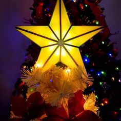 Unique Light-Up Christmas Tree Topper Color-changing LED glow + shines thousands of stars on your ceiling! Diy Christmas Tree, Christmas Tree Toppers, Outdoor Christmas, All Things Christmas, Vintage Christmas, Christmas Holidays, Christmas Ornaments, Christmas Stars, Holiday Lights