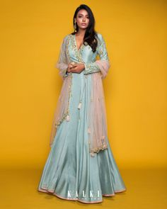 #MeriahCollection#TheFestiveEdit Presenting the best of post-wedding bridal look in crayon color, which is reinterpreted in vintage-inspired ways. This fit and flare 'Angrakha' silhouette is complemented by the baby blue hue and statement embroidery. The side-tie gives a modern look without compromising on the traditional vibes. Must-have for this festive season.✨ Western Gown, Western Dresses, Plain Dress, The Dress, Angrakha Style, Elie Saab Couture, Blouse Designs, Dress Designs, Teen Fashion Outfits