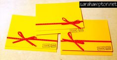 Yellow thank you cards with red bows at sarahampton.net.