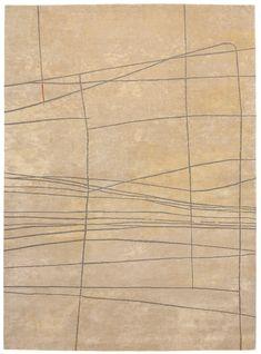 Golden beige, sand – grey green. Hand knotted in wool + silk, pattern in wool. Made in Nepal. Design Kristiina Lassus.