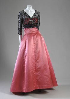 ~Cristobal Balenciaga pink strapless evening gown and black lace jacket. Pink ribbed silk satin, black net, glass beads, France, 1955. Worn by donor, Mrs. Henry R. Luce, née Clare Booth~