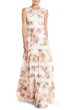 Adorned with a floral print throughout, this fit-and-flare gown from Needle & Thread is sure to make a style statement. Constructed from crepe and detailed with lace accents, this pastel piece is an easy way to brighten up your wardrobe. Wear yours with a matching clutch and pared-down accessories to allow the bright print to steal the spotlight.