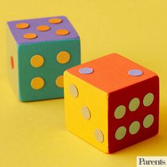 Challenge your children to come up with original games to play with these large, multicolor dice -- or simply watch them have a ball using the dice for their favorite board games. Make It: Have your children paint each side of two wooden blocks a different color. Select a variety of paper colors and punch out circles as the dice dots. Have your kids count out two sets of dots to glue on each of the blocks.