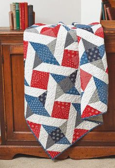 """This scrappy Quilt of Valor is quick to make with 10"""" pre-cut squares. Learn how to make triangle-squares eight at a time with our free Sew Easy lesson."""