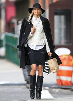 Karolina Kurkova made the NYC street her catwalk, bundling up in a chunky cable-knit sweater, black pencil skirt, and sexy leather boots. #fashion