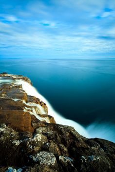 Bosdalafossur waterfall which flows from Sorvagsvatn, also known as Leitisvatn Lake, directly into Atlantic Ocean.