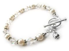 A bracelet that's both sweet and pretty. Made with creamy white AA grade freshwater pearls, Swarovski crystals and sterling silver. Finished with a sterling toggle clasp with a single silver heart charm. Pearl Jewelry, Sterling Silver Jewelry, Creamy White, Crystal Bracelets, Heart Charm, Fresh Water, Indigo, Swarovski Crystals, Pearls
