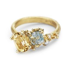 Ruth Tomlinson 14ct yellow gold asymmetric cocktail ring featuring citrine, aquamarine, pearl and white diamonds. Handmade in our central London studio.