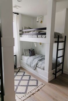 This is such a fun bunk room with built-in bunks and soft layers of pattern that feel like a subtle bohemian update on traditional. Read for images, details, and sources! Bunk Beds For Boys Room, Bunk Bed Rooms, Bunk Beds With Stairs, Cool Bunk Beds, Kid Beds, Bunk Bed Ideas For Small Rooms, Bunkbeds For Small Room, Trundle Bunk Beds, Boy Room