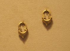 Parthian golden earrings that date back to the 2nd-3rd century CE. The city of Ctesiphon, the location of modern-day Baghdad, is the capital of the Hellenistic Parthian Empire that ruled modern-day Iran and Iraq from 247 BCE to 224 CE.