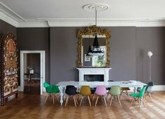 Grey walls, gold mirror, and chairs that pop...love it.