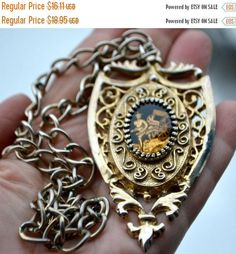 ON SALE Antique Rickshaw Driver Pendant Large Medallion Like Pendant on Silver Gold Chain Ornate Filigree and Scroll Work Frame Black