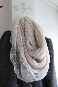 lace with knit - really pretty picture, link does not go to pattern though (just add a nice lace scarf to your knitted or crochet scarf:-)