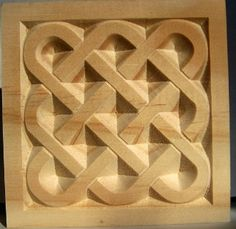 wood celtic basket weave style rosette corner block carved in pine