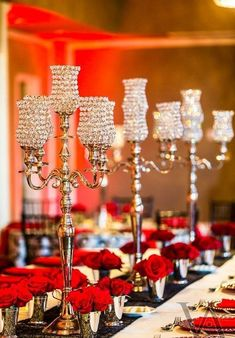 Red roses in Jjulep cups with crystal cup candelabras for long wedding tables