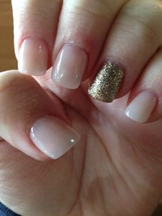 Done at Diva Nails in MJ. Pale pink and glittery gold acrylics. :)