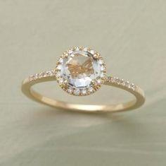 Pretty dainty engagement ring. Love!