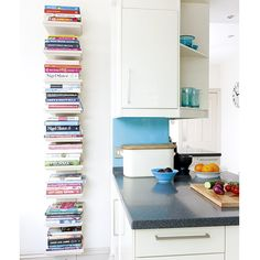Kitchens: White Kitchen with Wall Mount Book Shelves also White Cabinetry and Dark Countertop