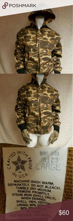 "Boys Coat Boys large camouflage Carhartt Coat  arm pit to arm pit 23"" shoulder to hem    21"" NOTE: Includes a pair of Real Tree camouflage gloves the thumb on the right hand has a small tear that has been repaired. Carhartt Jackets & Coats"