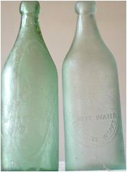 These antique bottles look a little sick with the oxidation on the glass causing it to appear cloudy and damaged