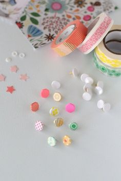 Spice up that bulletin board with these washi tape covered tacks
