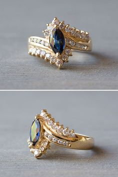 A vintage 1980's 14k yellow gold marquise cut blue Sapphire engagement ring, with diamonds, offered by MintAndMade.