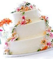 Simple Wedding Cakes with Fresh Flowers  (different flowers tho... maybe orchids or calla lily's!)